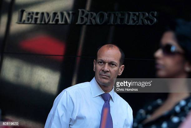 A man stands outside the headquarters of the financial firm Lehman Brothers Holdings Inc September 15 2008 in New York City Lehman Brothers filed a...