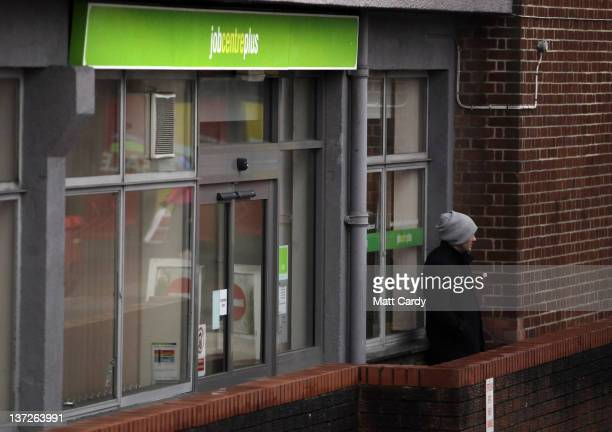 A man stands outside the Jobcentre Plus on January 18 2012 in Trowbridge England Figures released today show that the UK unemployment rate has risen...