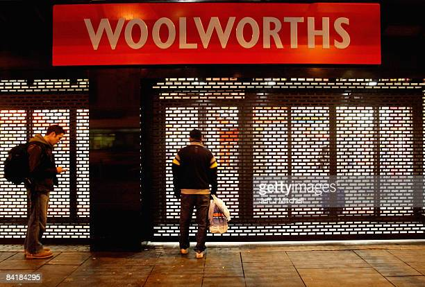 A man stands outside Woolworths in Argyll Street as the store closes for the final time on January 6 2009 in Glasgow Scotland People have been...