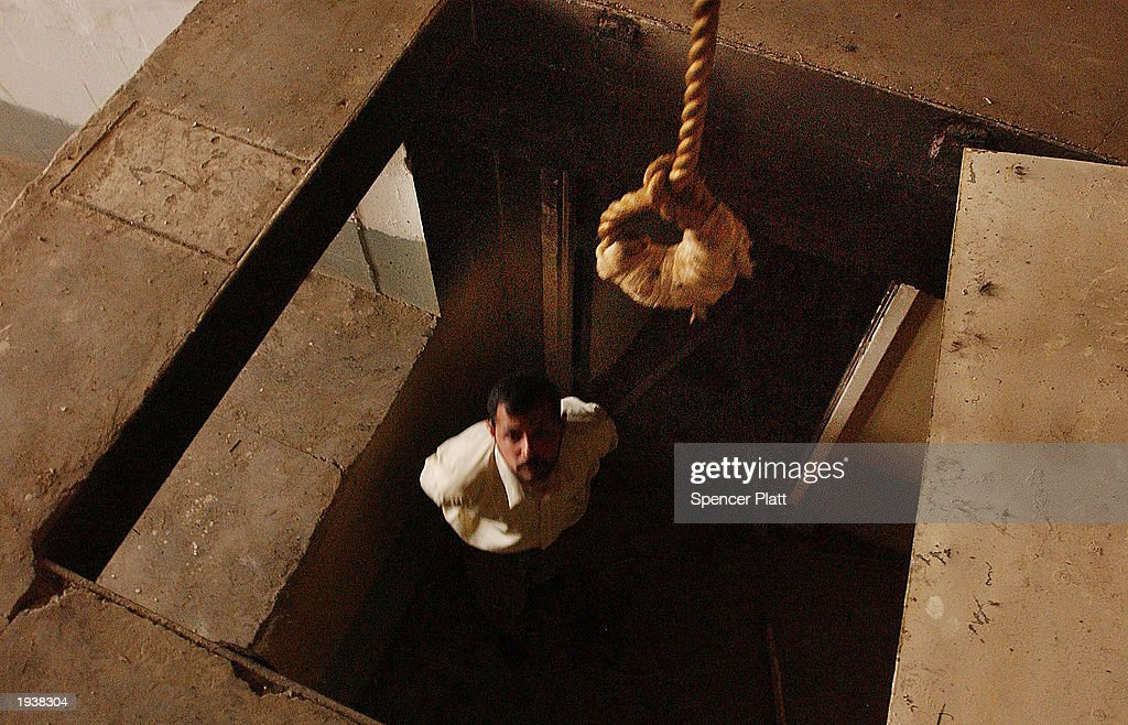 A man stands under a noose at the gallows of the infamous Abu Greib prison April 18 2003 in Baghdad Iraq Thousands of people disappeared into the...