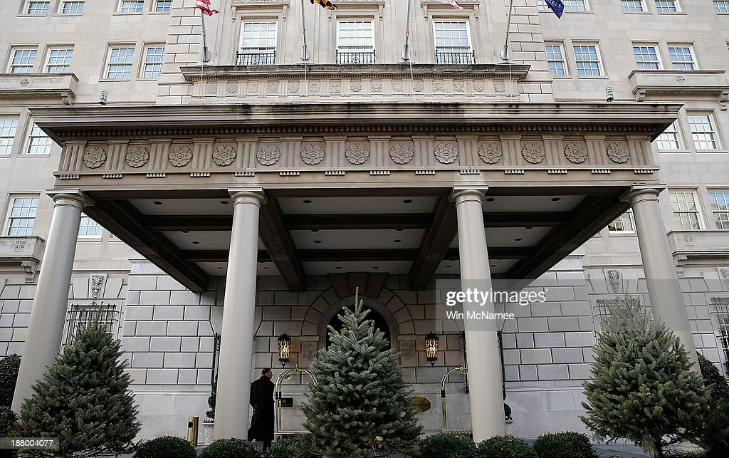 A man stands under the portico of the Hay-Adams Hotel on November 14, 2013 in Washington, DC. Two U.S. Secret Service agents were removed from U.S. President Barack Obama's protective detail after an internal investigation revealed that an agent allegedly tried to re-enter a female guest's hotel room after leaving behind a bullet from his service weapon, and also that the two agents had allegedly sent sexually suggestive emails to a female subordinate.