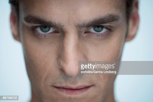 Man staring at camera, close-up