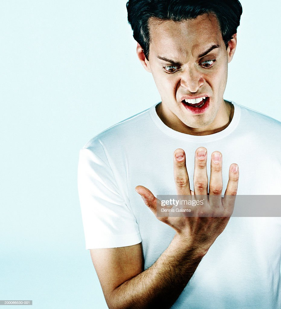 Man staring at palm of hand, close up : Stock Photo