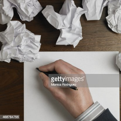 Man starts to write on blank paper.