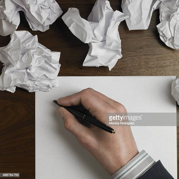 Man starts to write on blank paper.