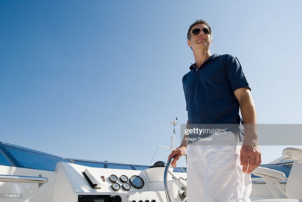 Man steering a yacht : Stock Photo