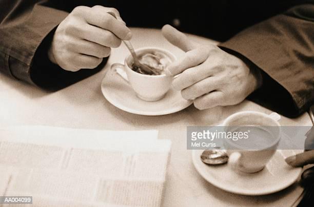 Man Stirring His Coffee