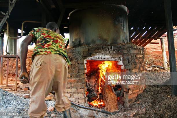 A man stokes a kiln at a small factory in Gahara in the Southeast of Rwanda on April 28 2017 Last year Rwanda exported around 14 tonnes of essential...