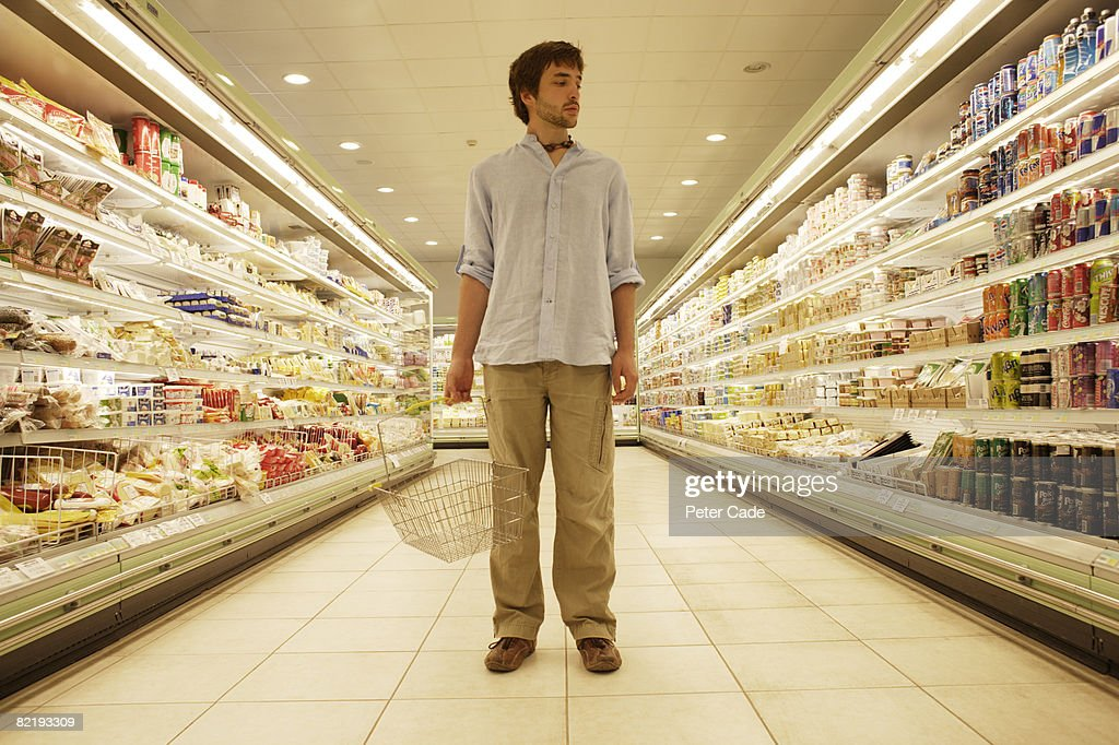 Man stood in supermarket : Stock Photo