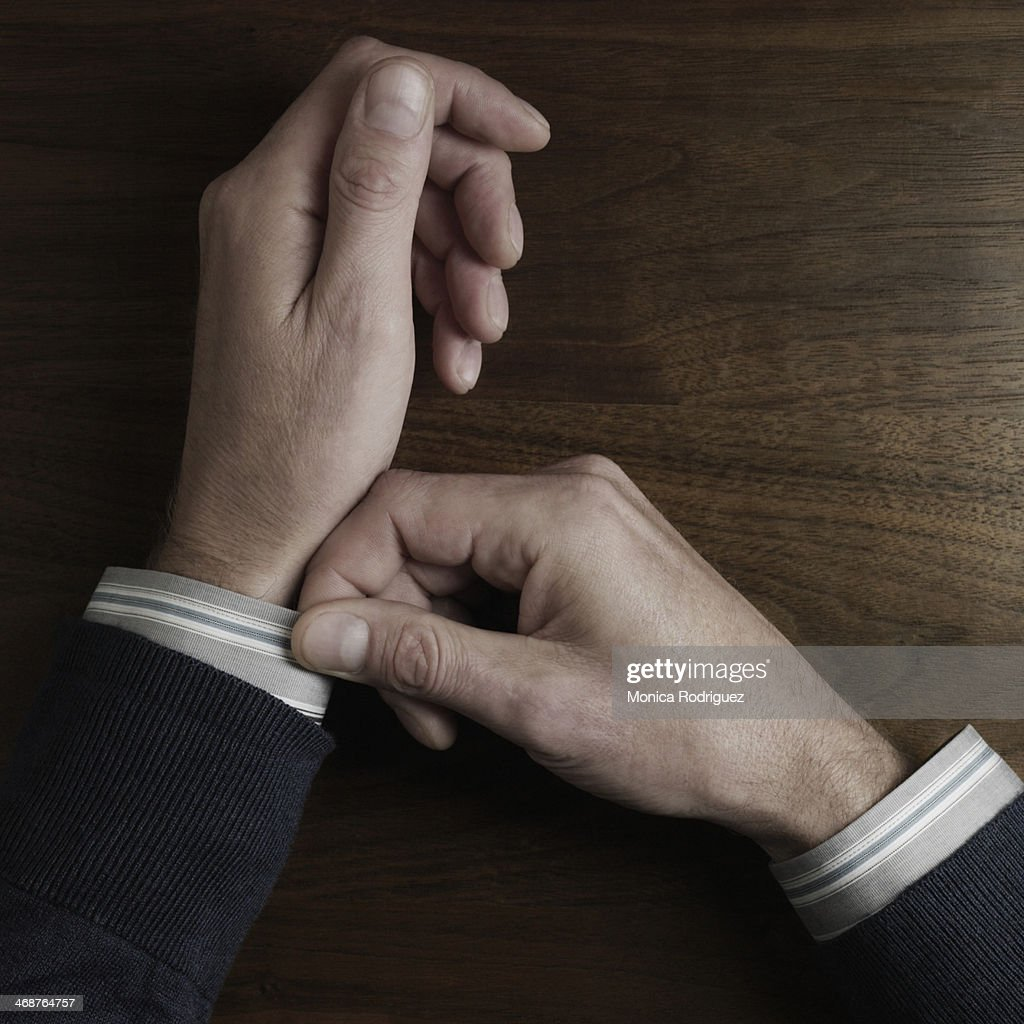 Man straightening sleeve : Stock Photo