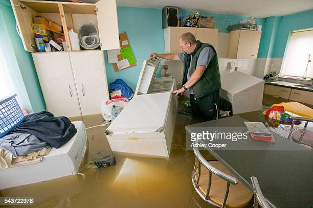 A man stranded in his flooded house searches for food in Toll Bar near Doncaster UK flooded in the June 2007 unprecedented summer floods | Location...