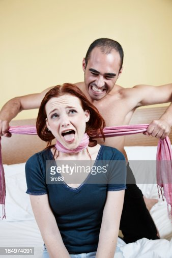 man strangling woman with scarf on bed stock photo getty
