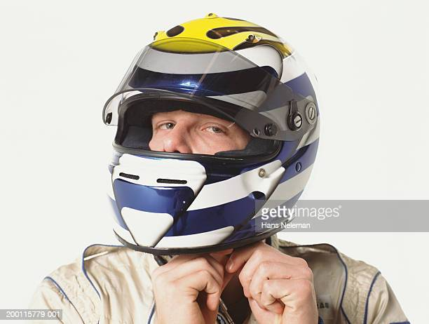 Man strapping on motorcycle helmet, close-up