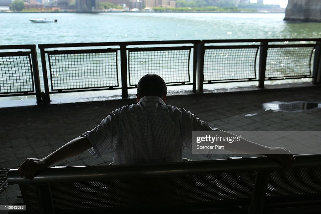 A man stretches in the shade by the East River during record breaking heat on June 21, 2012 in New York City. New York City and much of the East Coast have been experiencing a second day of hot weather with temperatures of 98 degrees Fahrenheit (37 Celsius) being predicted in Central Park. High heat warnings and air quality alerts have been issued from Quebec to Virginia. Temperatures are not expected to cool down until the start of next week.