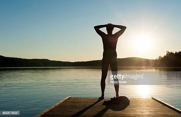 A man stretches out on a jetty