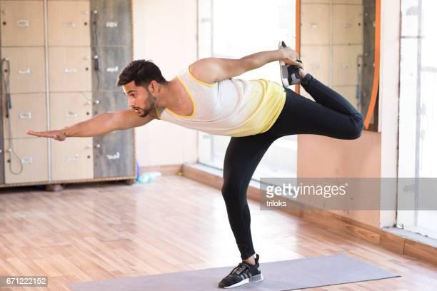 Man stretching at gym