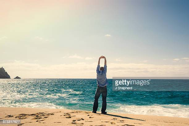 Man stretching at the coast