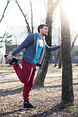 Man stretching before workout outdoors