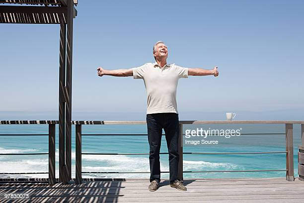 Man stretching by the sea