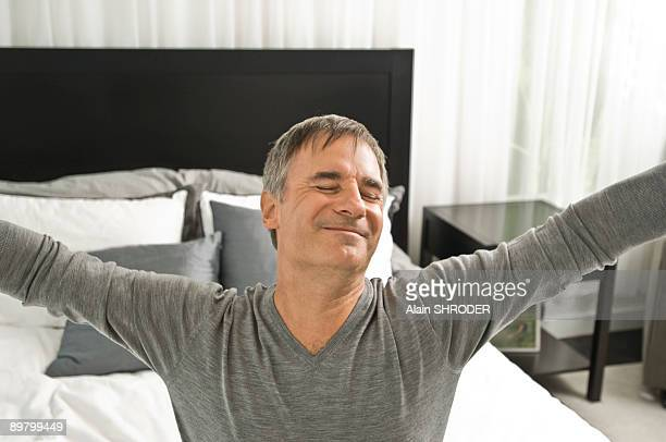 Man stretching in the bed