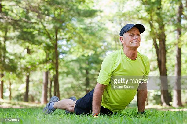 Man stretching on grass
