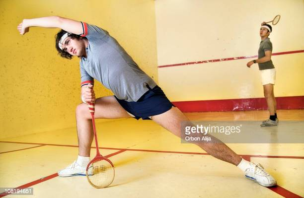 Man Stretching on Squash Court Holding Racket