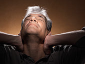 Man stretching with hands on neck