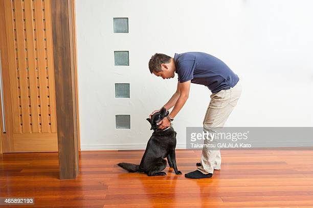 Man stroking his pet dog