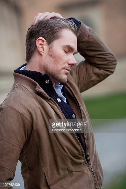 Man stroking through his hair