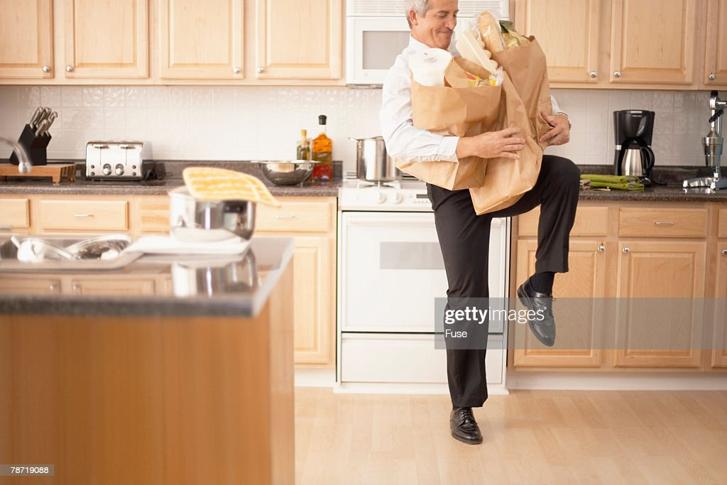 Man Struggling with Grocery Bags