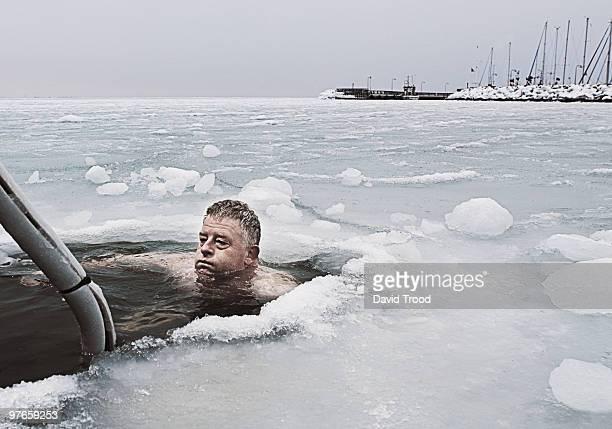 Man submerged in frozen sea.
