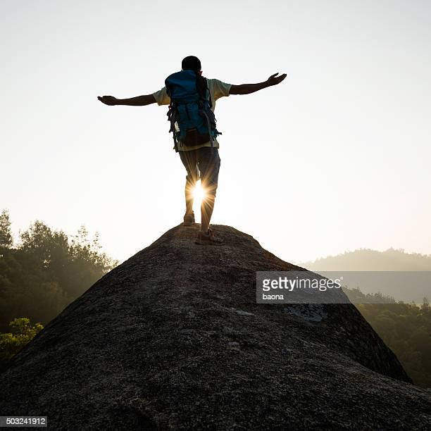 Man success standing at mountain peak