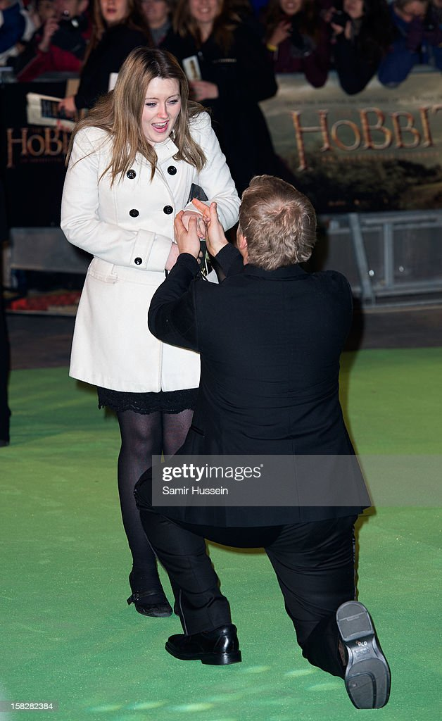 A man successfully proposes to his girlfriend at a royal film performance of 'The Hobbit: An Unexpected Journey' at The Empire Leicester Square on December 12, 2012 in London, England.