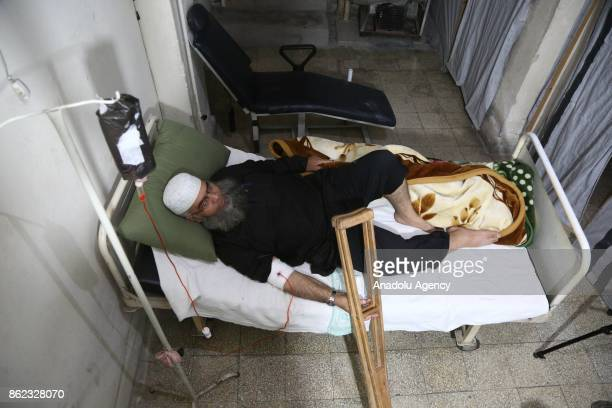 A man suffering from cancer receives chemotherapy at AlRahmat Center which was found in 2013 and serves for the cancer patients in Eastern Ghouta of...