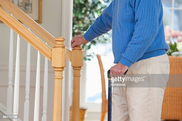 Man suffering from Parkinson's disease and multiple sclerosis standing near steps