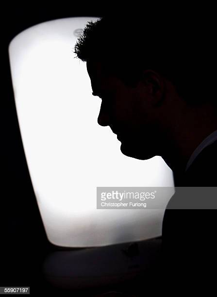 A man suffering from Seasonal Affective Disorder uses a light box in his office to combat the illness on October 12 2005 in Glasgow Scotland Seasonal...