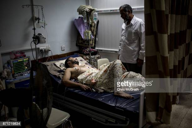 A man suffering from seizures is seen in the ICU department of the small temporary hospital across the street from the destroyed Salam Hospital on...