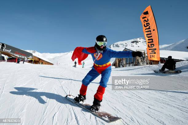 A man suited as Superman the comic book hero rides on the French Alpine slopes on February 12 2012 at Les Menuires ski resort eastern France on the...