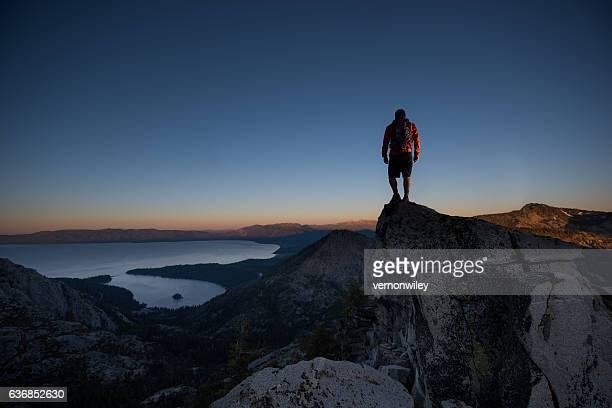 Man summiting a beautiful mountain top in Lake Tahoe