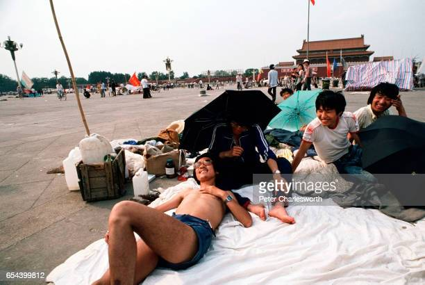 A man sunbathes as Tiananmen Square takes on a beachlike atmosphere Prodemocracy demonstrators and protestors filled the square for weeks prior to...