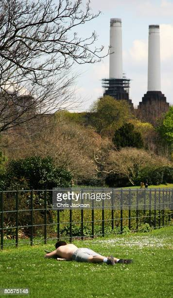 A man sunbathes in Battersea Park on April 9 2008 in London England After a spell of cold weather and snow over the weekend the sun is beginning to...