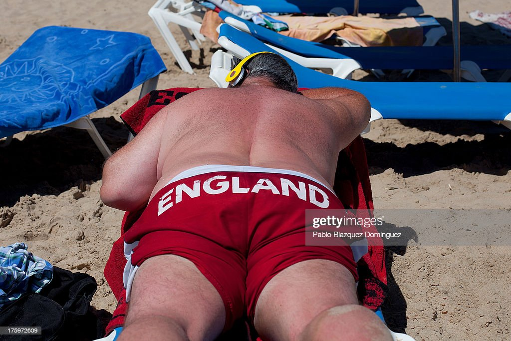 A man sunbathes on Levante Beach on August 10, 2013 in Benidorm, Spain. Benidorm is one of Europe's top package holiday destinations and one of Spain's busiest tourist destinations. The Costa Blanca hotspot of Benidorm is calculated to have a population of around 72,000, which is estimated to rise to more than 300,000, during the summer months as the tourists and visitors flock to its popular beaches.