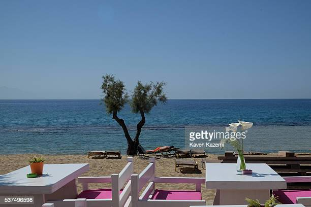 A man sunbathes while lying on a sundeck by the sea on April 17 2016 in Mykonos Greece Paradise Beach is one of the most famous beaches on the island