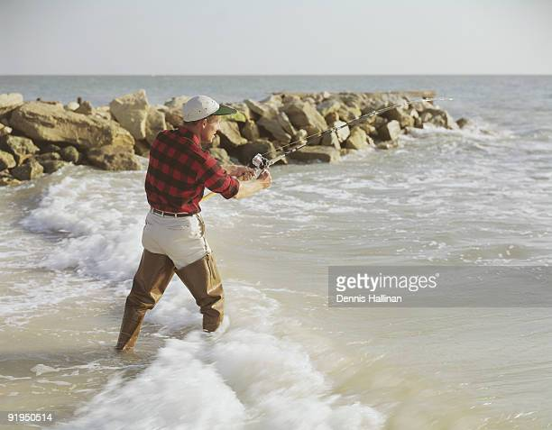 Waders stock photos and pictures getty images for Surf fishing waders