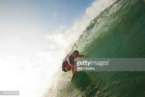 Man Surfing a barrel wave in Nicaragua : Stock Photo