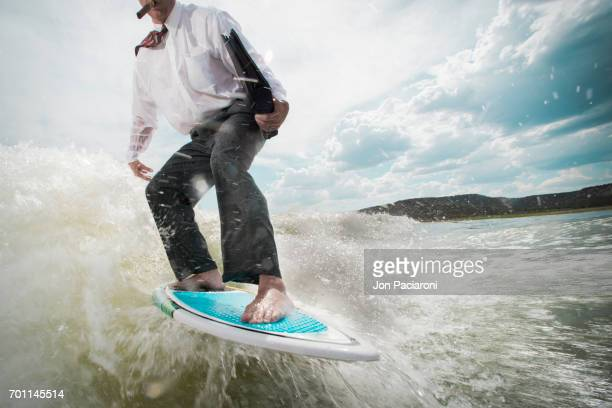Man Surfing in Dry Business Attire