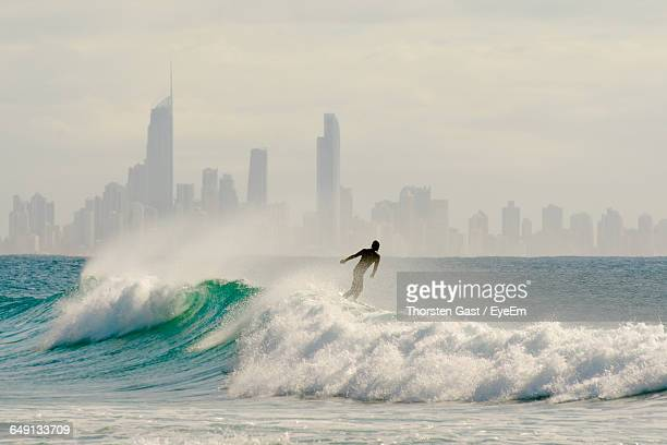 Man Surfing On Sea Waves At Surfers Paradise