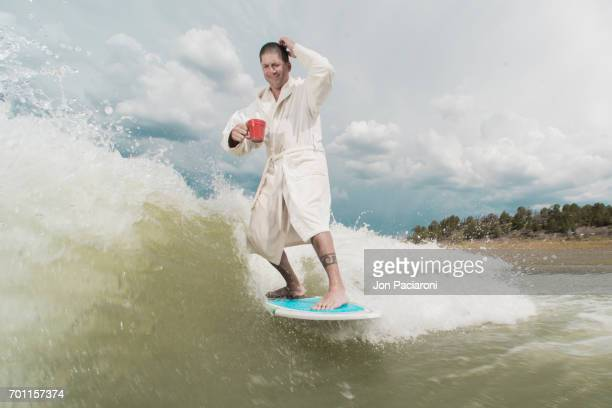 Man surfing Wearing a Bathrobe