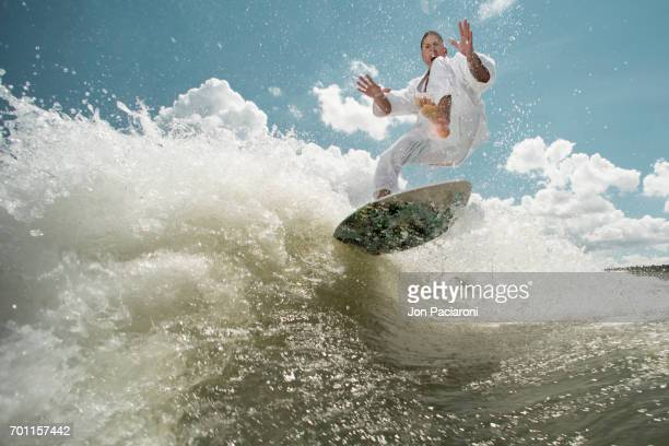 Man Surfing while Attempting Martial Arts