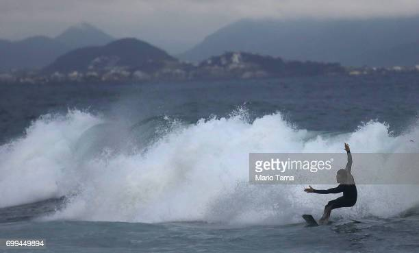 A man surfs in a wetsuit near Arpoador rock on the first day of winter on June 21 2017 in Rio de Janeiro Brazil Today's solstice marked the beginning...